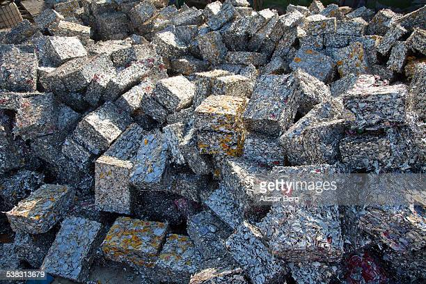 Recycled blocks of aluminium in scrap yard