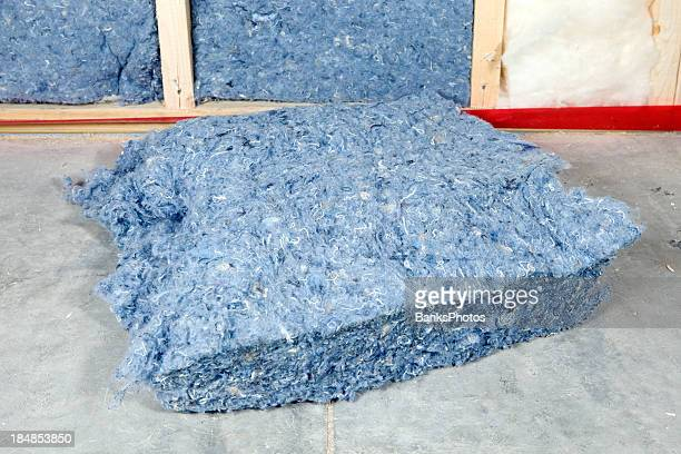 recycled blue jean denim insulation near wall frame - jeans stock pictures, royalty-free photos & images