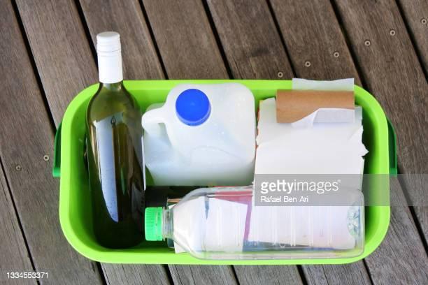 recycled items inside home recycling box container - rafael ben ari fotografías e imágenes de stock