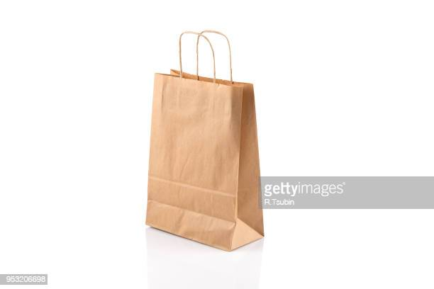 Recycled paper craft shopping bag isolated on white background