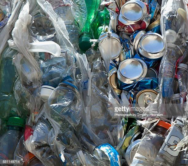 recycled plastic bottles and crushed aluminum cans - timothy hearsum stock pictures, royalty-free photos & images