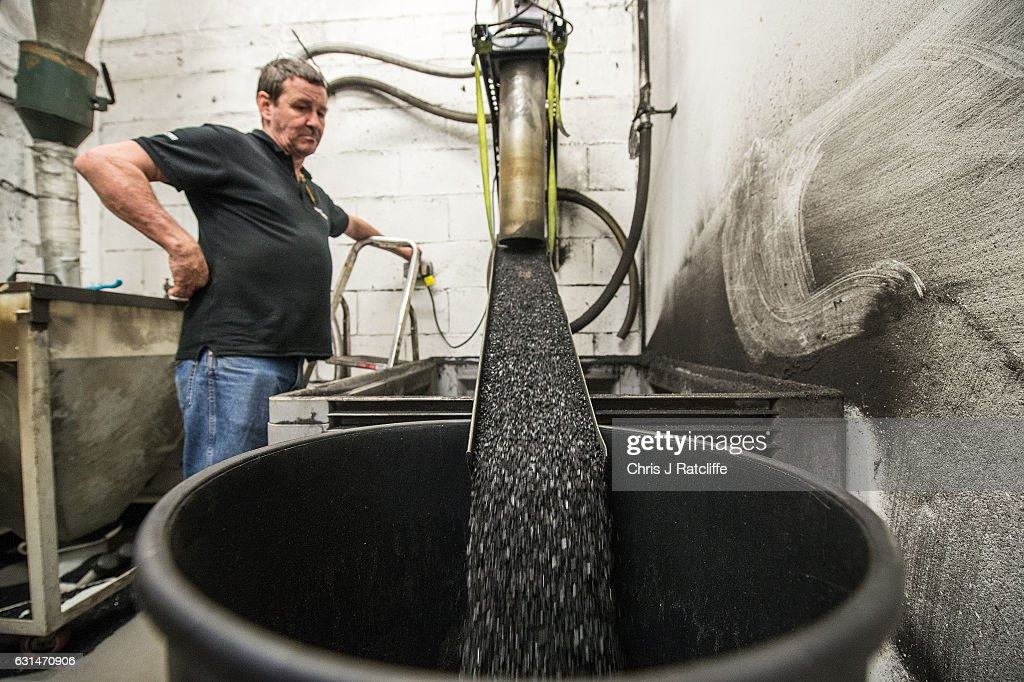 Recycled PVC pellets are emptied into a bin after being ground from faulty vinyl records produced in the factory at The Vinyl Factory on January 11, 2017 in Hayes, England. The Vinyl Factory is the largest vinyl pressing plant in the United Kingdom and produces up to 1.4 million records a year. The factory was founded in 2001 and has seen a 20% increase in sales and production year on year with clients including Warner Music, Universal Music, Bjork's label and their own label. Sales of vinyl records reached a 25 year high in 2016 when more than 3.2 million LPs were sold, a rise of 53% on the previous year.