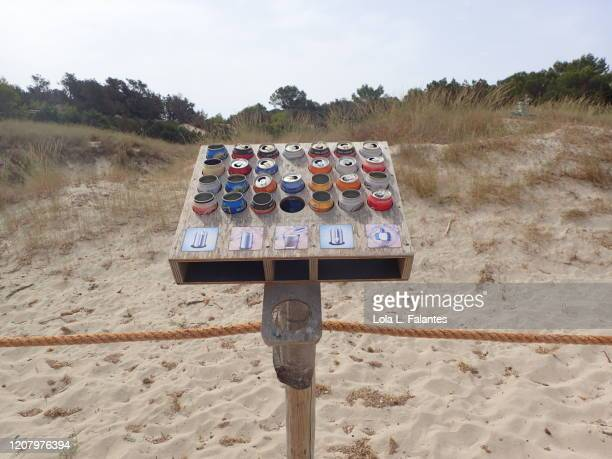 recycled soda cans. cala saona. formentera island - lola lane stock pictures, royalty-free photos & images