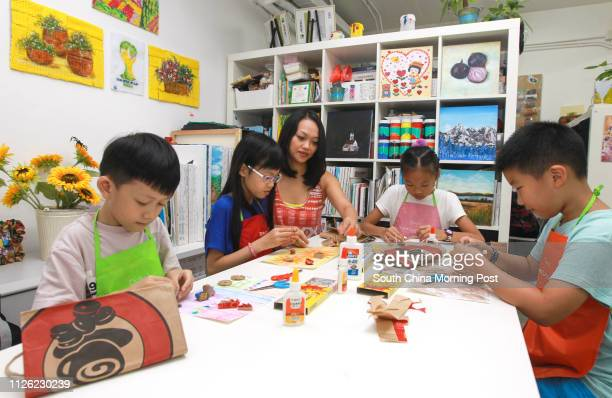 Recycling Artworks class for Kids at Draw 2 Studio in Wan Chai Pictured Lleyton Chan 7 yrs old teacher Megan Lau 8 yrs old Agnes Pang Shukyee Venus...