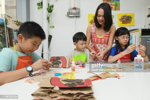 Recycling Artworks class for Kids at Draw 2 Studio in Wan Chai Pictured Dicky Wu 8yrold Lleyton Chan 7yrold teacher Agnes Pang Shukyee and Megan Lau...