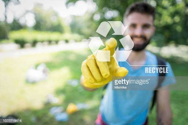 recycling awareness in the city park - ecologist stock pictures, royalty-free photos & images