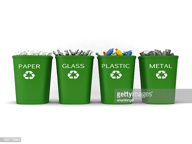 Recycling bins filled with paper, glass, plastic and metal