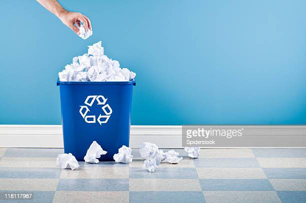 recycling container with crumpled paper - hurling stock photos and pictures