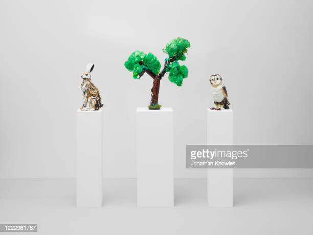 recycling gallery exhibition  - rabbit, owl, tree - extinct stock pictures, royalty-free photos & images