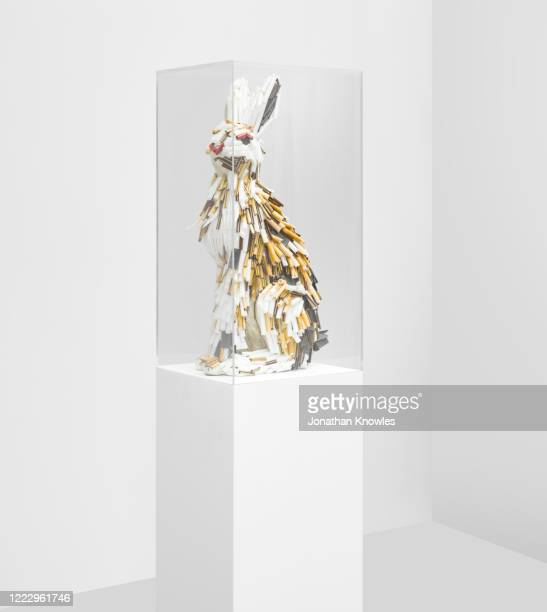 recycling gallery exhibition  - recycled plastic rabbit sculpture - extinct stock pictures, royalty-free photos & images