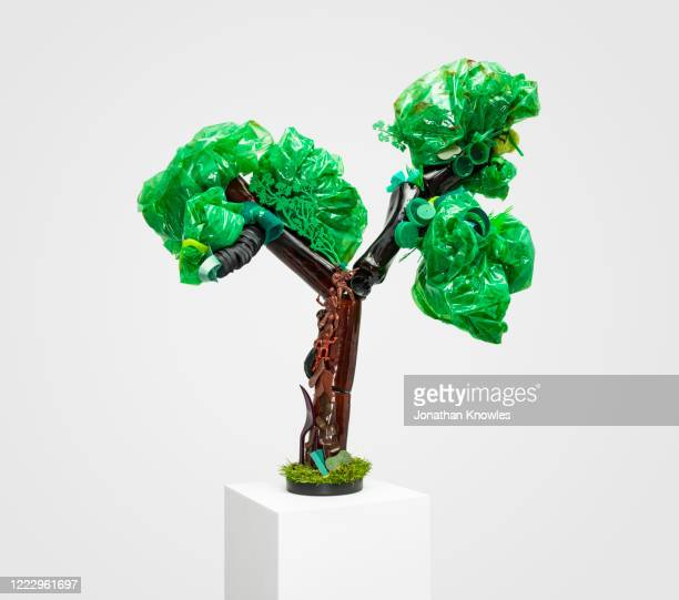 recycling gallery exhibition  - recycled plastic tree - extinct stock pictures, royalty-free photos & images