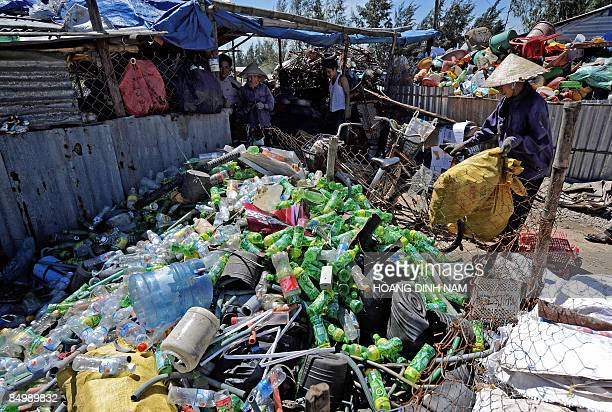 Recycling good collector sells what she has collected at a local trader's near Vietnam's first oil refinery at Dung Quat on February 22, 2009 in the...