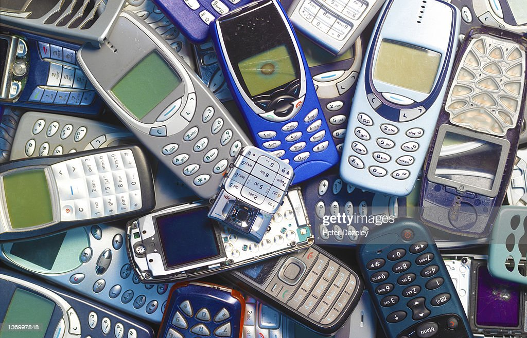 Recycling obsolete mobile phones : Stock Photo