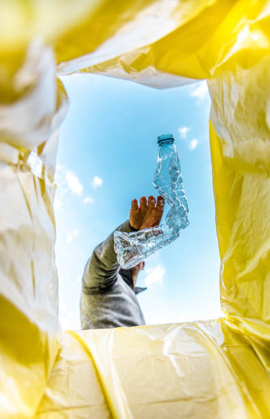Recycling single use plastic bottle with creative view from inside the bin.