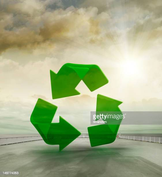 Recycling symbol in sunny cargo ship deck