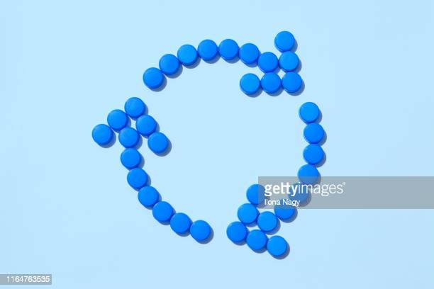 recycling symbol made of plastic bottle caps - cap stock pictures, royalty-free photos & images