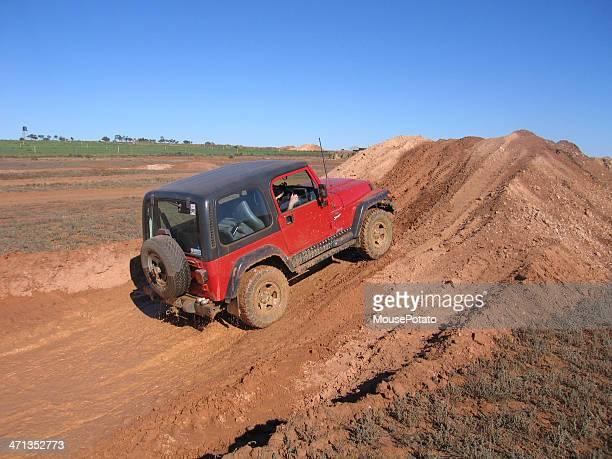 Red 1997 TJ Jeep Wrangler on 4x4 test track