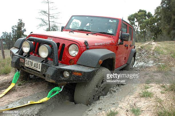 Red 2007 Jeep JK Wrangler Rubicon stuck mud, border track