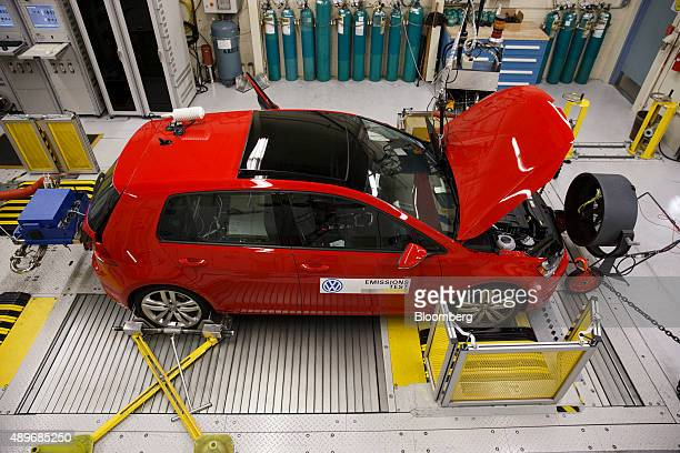 A red 2016 Volkswagen AG Golf TDI emissions certification vehicle waits to be tested inside the California Air Resources Board HaagenSmit Laboratory...