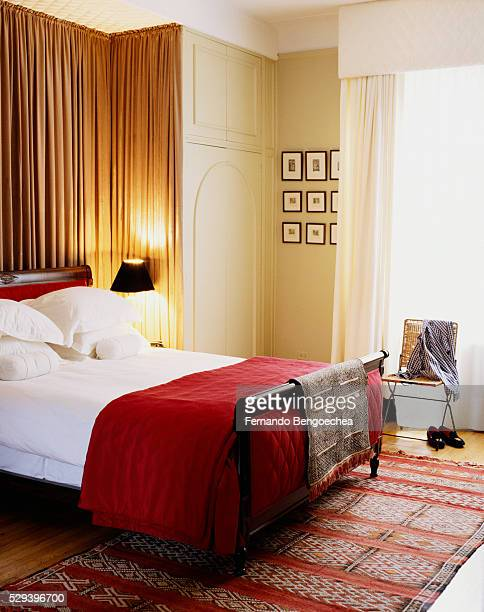 Red Accents in Traditional Bedroom