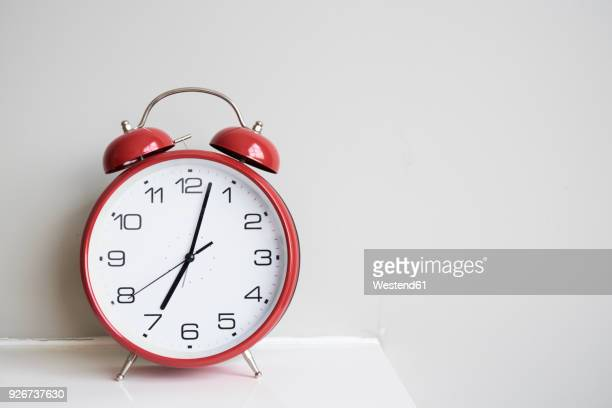 red alarm clock - alarm stock photos and pictures