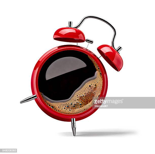 Red alarm clock with black coffee