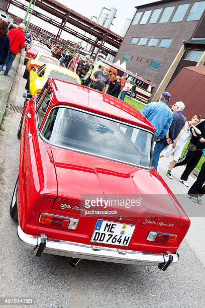 red alfa romeo giulia super 1.3 oldtimer - alfa romeo stock pictures, royalty-free photos & images