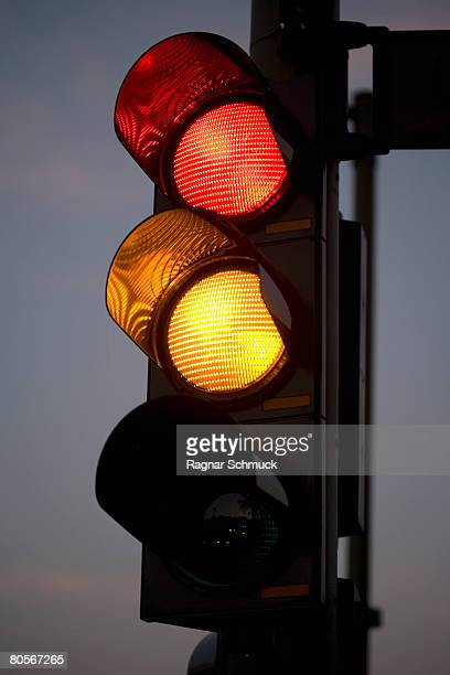 A red and amber traffic light