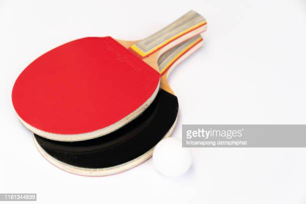 red and black rackets for playing table tennis on a white background, top view, sport concept - table tennis racket stock pictures, royalty-free photos & images
