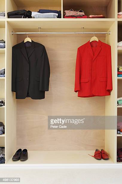 Red and Black suits hanging in wardrobe