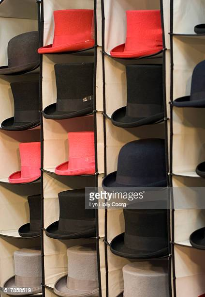 red and black top hats and bowler hats for sale - lyn holly coorg stock pictures, royalty-free photos & images