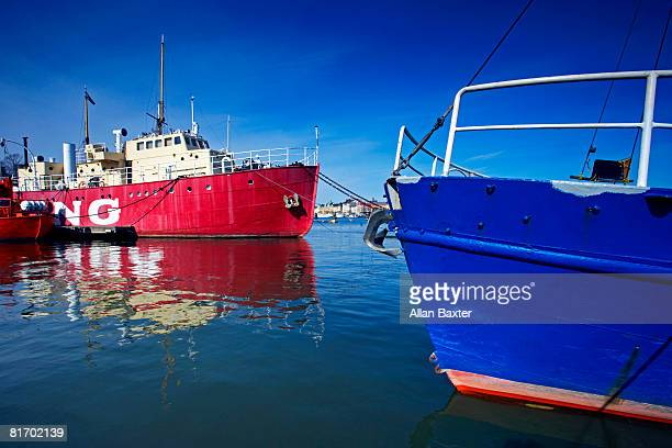 Red and blue boat in water