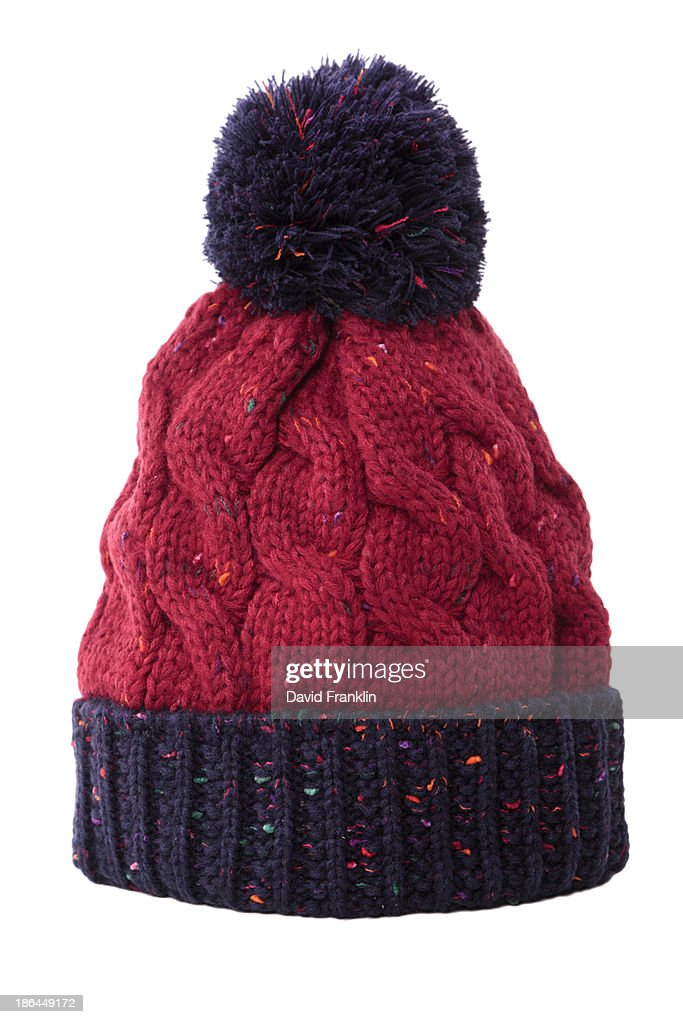 Red and blue bobble hat : Stock Photo