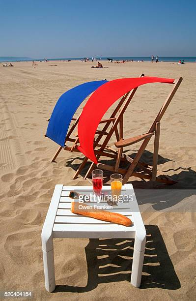 red and blue chairs with white table - calvados stock pictures, royalty-free photos & images