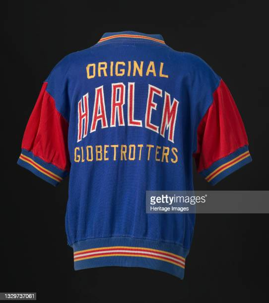 Red and blue Harlem Globetrotters shooting shirt. The front of shirt features a zipper running vertically down from the neck to the top of the chest....
