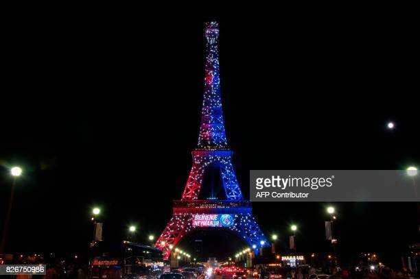 Red and blue lights and a welcoming message that reads in French Welcome Neymar adorn the Eiffel Tower to celebrate the arrival of Brazilian...