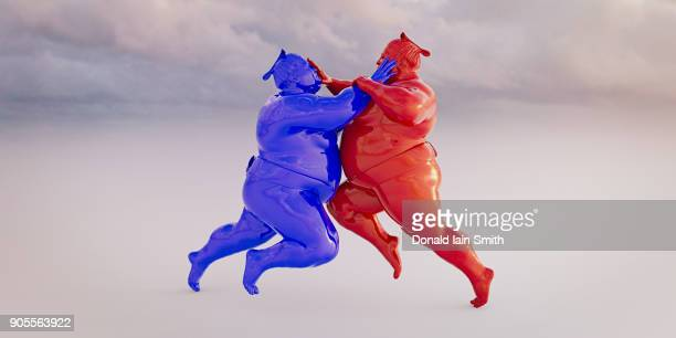 Red and blue sumo wrestlers fighting