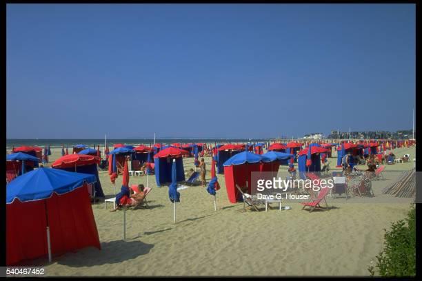 Red and Blue Umbrellas Along Beach