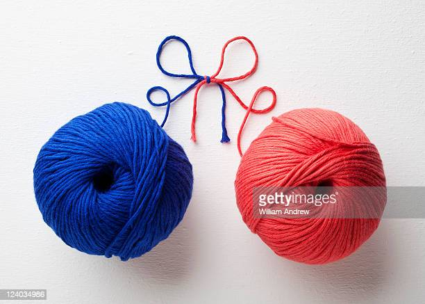 Red and blue yarn tied together