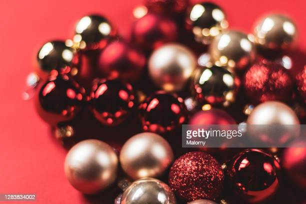 red and gold christmas ornaments on red background picture