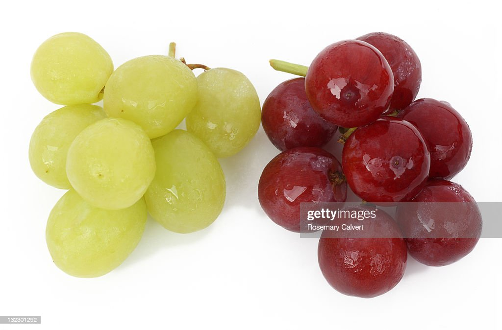 Red and green grapes, choice and contrast. : Stock Photo