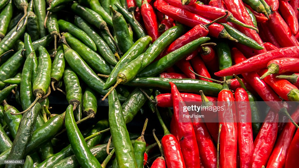 Red and green peppers : Stock Photo