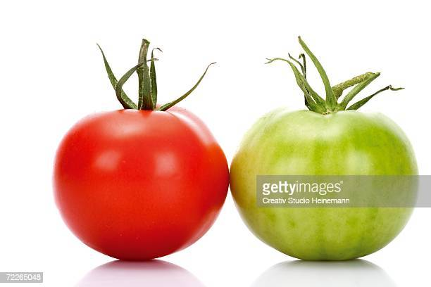 Red and green tomato, close-up