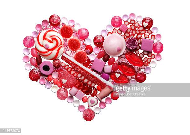 red and pink food heart made out of candy & sweets