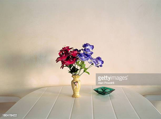 Red and purple flowers on plastic table