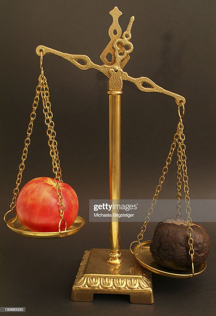 Red and rotten apple on a scale : Stock Photo