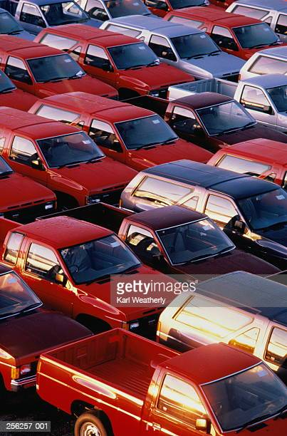 red and silver nissan trucks in car park - nissan stock pictures, royalty-free photos & images