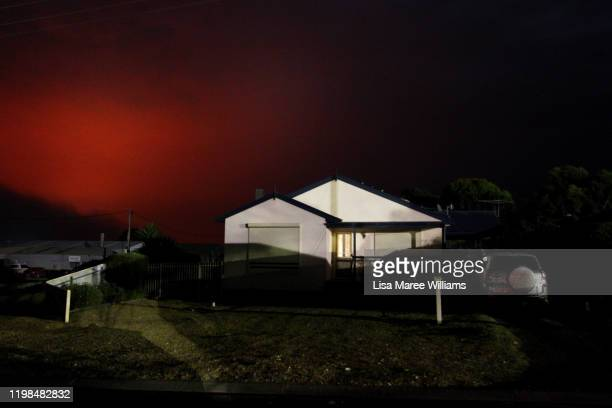 A red and smoke filled sky is seen above the central township of Kingscote in the early hours of January 10 2020 in Kingscote Australia Residents of...