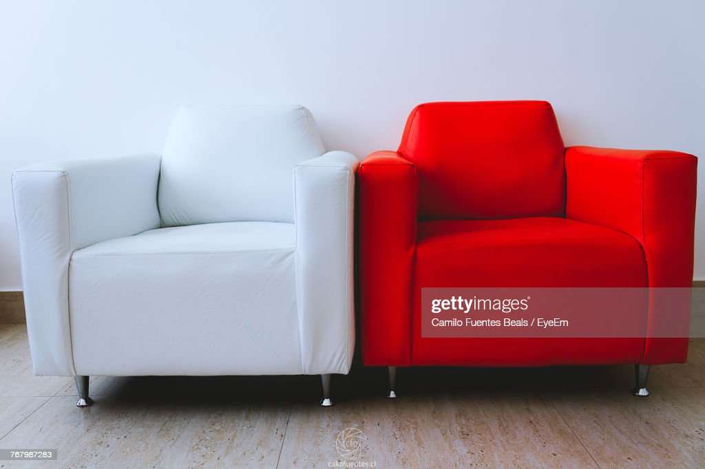 Terrific Red And White Armchair Against Wall At Home High Res Stock Pabps2019 Chair Design Images Pabps2019Com