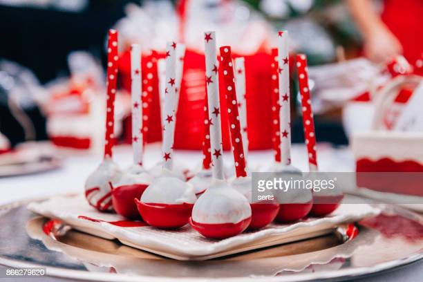 red and white cake pops - christmas cake stock photos and pictures